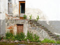 Entrance steps to an old and abandoned building Royalty Free Stock Photos