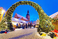 Entrance to the christmas market in riga latvia december s old town made of spruce boughs and fairy lights latvia Royalty Free Stock Photo