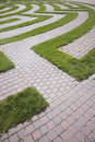 Entrance to a Cobblestone and Grass Maze Royalty Free Stock Photo