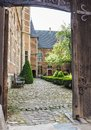 Entrance to the elegant and tranquil courtyard of the 15th centu Royalty Free Stock Photo