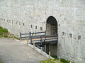 Entrance to a fort an an old with bridge over dry moat Stock Image