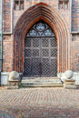 The entrance to the medieval cathedral side door st mary s basilica in gdansk poland Stock Images