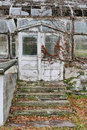 Entrance to Rustic Greenhouse Ruins Royalty Free Stock Photo