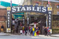Entrance to the stables market in camden london uk st march showing shoppers near Royalty Free Stock Photos