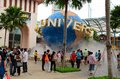Entrance to universal studios theme park sentosa island singapore august tourists and visitors mill around the famous globe icon Stock Image