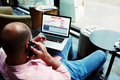 Entrepreneur busy work with statistics data discussing performance via mobile phone call young businessman sitting front laptop Stock Photo