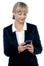 Entrepreneur reading message on her mobile Royalty Free Stock Images