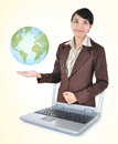 Entrepreneurs out of the laptop and smiling holding the earth in his hands isolated on yellow background Stock Images