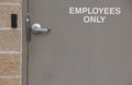 Entry door for employees only taupe entrance with card key Royalty Free Stock Image