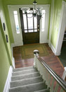 Entry hall stairs and front door Royalty Free Stock Photo