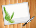 Envelop an and a pen on wooden planks Royalty Free Stock Image