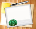 Envelop sheet and with pen on wooden background Royalty Free Stock Images