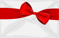 Envelope with a big red bow and ribbon Royalty Free Stock Photo