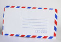 An envelope is a common packaging item usually made of thin flat material it is designed to contain a flat object such as a letter Stock Photo