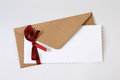 Envelope decorated with red ribbon Royalty Free Stock Photo
