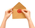 Envelope and e-mail in the hands of women Stock Photo