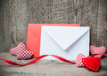 Envelope with red hearts for valentines day on wooden background Stock Photography