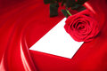 Envelope and red rose over silk background Stock Photography