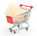 Envelope in shopping cart on white