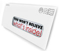 Envelope special delivery you wont believe whats inside won t what s words through the window of an of offers or news delivered to Royalty Free Stock Photo