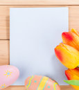 Envelope with Tulips and Easter Eggs Royalty Free Stock Photo