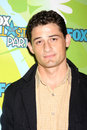 Enver gjokaj fox tv tca july party arriving at the at the langham huntington hotel spa in pasadena ca on august Royalty Free Stock Photography