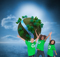 Enviromental activists jumping and smiling composite image of three Stock Photography