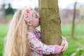 Environment beautiful girl kissing a tree environmental concept Stock Images
