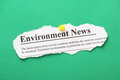 Environment news newspaper clipping for pinned to a green paper background Royalty Free Stock Photography
