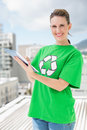 Environmental activist wearing recycling tshirt using tablet outside on a sunny day Stock Image