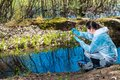 Environmental disaster, environmentalist chemist explores the water Royalty Free Stock Photo