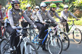 Environmentally friendly campaign police woman riding a bicycle while patrolling the streets of surakarta indonesia activities as Stock Photo