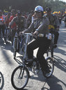 Environmentally friendly campaign police woman riding a bicycle while patrolling the streets of surakarta indonesia activities as Stock Images