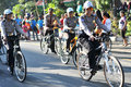 Environmentally friendly campaign police woman riding a bicycle while patrolling the streets of surakarta indonesia activities as Stock Photos