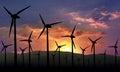 Eolian farm renewable energy against sunset Stock Image