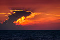 Epic suset sky with majestic clouds sunset scenery and the sun that looks like a fireball over the sea Stock Photos
