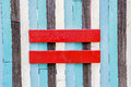 Equal sign symbol on the wooden wall Royalty Free Stock Images