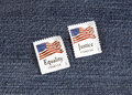 Equality and justice forever two stamps promoting against blue denim Royalty Free Stock Photo