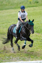 Equestrian sport. Cross-coutry. Woman eventer on horse is overcomes the hurdle Stock Images