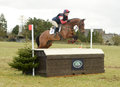 Equestrian sport horse jumping louisa lockwood on avocado rd int sec h gatcombe Royalty Free Stock Image