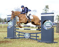 Equestrian sport horse jumping selina milnes and bodidly nd open intermediate section k gatcombe trials Stock Image