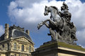 Equestrian statue of king louis xiv in courtyard of the louvre museum made by gian lorenzo bernini Stock Images