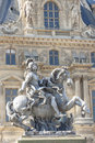 Equestrian statue of king louis xiv paris france april in the courtyard the louvre museum on april in paris made by gian Royalty Free Stock Image