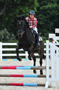 Equestrianism hurdle race recreational activities Stock Photo