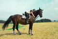 Equestrienne and horse horsewoman lay down on the withers of the Stock Photo