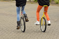 Equilibration balancing girls driving unicycles outdoors Royalty Free Stock Images