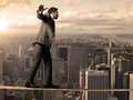 Equilibrist businessman Stock Image