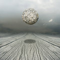 Equilibrium artistic metaphysical background representing a ball sculpture floating in the air above a wooden floor with the sky Royalty Free Stock Photography