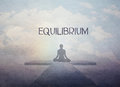 Equilibrium concept vintage and inner harmony female yoga figure against blue sky background Royalty Free Stock Images