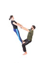 Equilibrium exercise picture of two people doing an isolated on white Royalty Free Stock Images